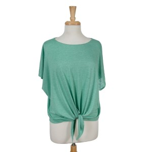 Mint green short sleeve top with a tie front. 65% viscose and 35% polyester. One size fits most.