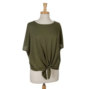 Olive green short sleeve top with a tie front. 65% viscose and 35% polyester. One size fits most.