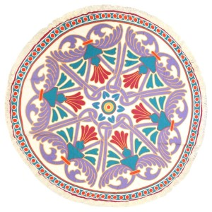"""Ivory roundie displaying a purple, pink, green, and yellow pattern and a fringe edge, can be used as a beach throw, rug or tapestry. 100% viscose. Approximately 72"""" in diameter."""