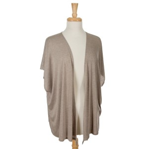 Taupe short sleeve open overlay. 65% viscose and 35% polyester. One size fits most.