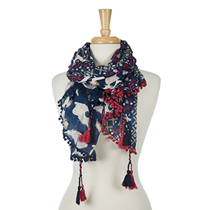 "Navy blue floral printed, lightweight open scarf with tassels on the corners. 100% viscose. Measures 45"" x 80"" in size. Made in India."