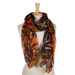 "Navy blue, orange, and yellow abstract printed open scarf. 100% polyester. Measures 70"" x 42"" in size."