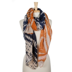 "Navy blue and orange tie-dye printed open scarf. 100% viscose. Measures 36"" x 72"" in size."