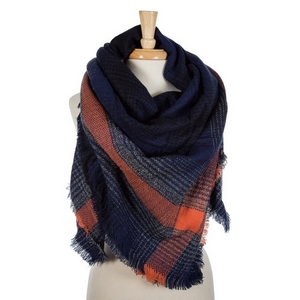 "Navy blue and orange plaid blanket scarf with frayed edges. 100% acrylic. Measures 56"" x 56"" in size."