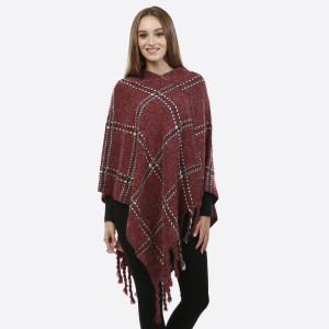 Burgundy poncho with a plaid design and tassel accents. 100% acrylic. One size fits most.