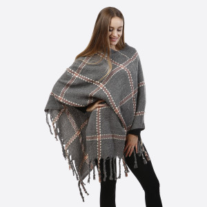 Gray poncho with a plaid design and tassel accents. 100% acrylic. One size fits most.