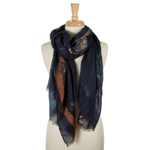 """Navy blue, lightweight open scarf with a swirl pattern. 100% viscose. Measures 36"""" x 72"""" in size."""