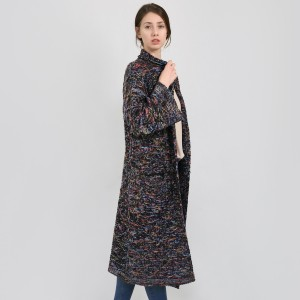 Black knit, heavyweight, cardigan with multicolored accents and two front pockets. 92% acrylic and 8% polyester. One size fits most.