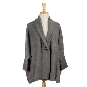 Gray knit sweater with an oversized, dolman fit and a front wooden button. 100% acrylic. One size fits most.