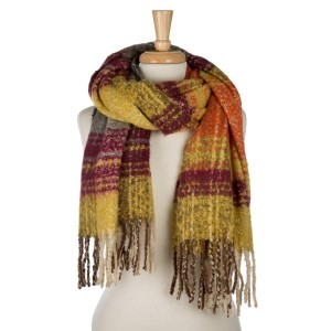 "Soft, heavyweight, open scarf with a tweed pattern and fringe on the ends. 100% acrylic. Measures 24"" x 72"" in size."