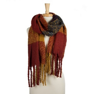 """Super soft, heavyweight, open scarf with a plaid pattern and tassels on the ends. 100% polyester. Measures 20"""" x 72"""" in size."""