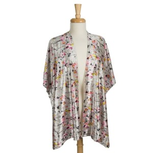 Crushed velvet, short sleeve kimono with a small floral pattern. 95% polyester and 5% spandex. One size fits most.