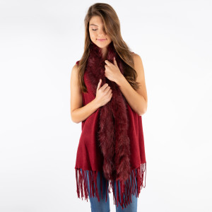 Heavyweight, sleeveless vest with a faux fur lining along the front and fringe along the bottom. 100% acrylic. One size fits most.