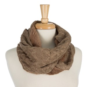 """Knit infinity scarf with a faux fur inside lining. 100% acrylic. Measures 10"""" x 31"""" in size."""