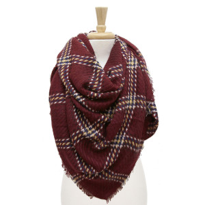 "Plaid blanket scarf with frayed edges. 100% acrylic. Measures 58"" x 58"" in size."