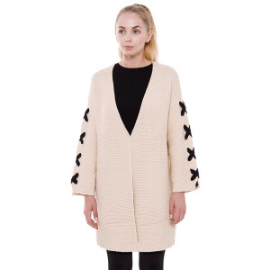 Beige, heavyweight knit cardigan with black lace up sleeves, a front clasp closure and an oversized fit. 100% acrylic. One size fits most.