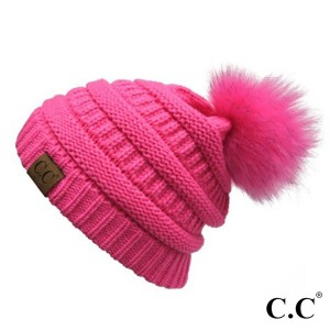 Cable knit, original C.C beanie with a self color faux fur pom pom, in new candy pink. 100% acrylic.