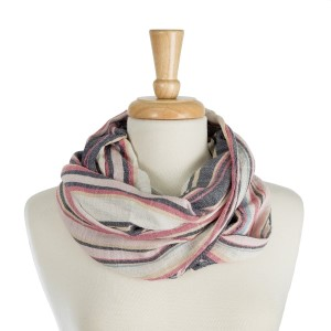 "Lightweight, infinity scarf with a stripe print. 100% polyester. Measures 20"" x 30"" in size."