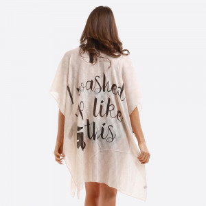 "Lightweight kimono/swimsuit cover up with ""I Washed Up Like This"" on the back. 100% viscose. One size fits most."