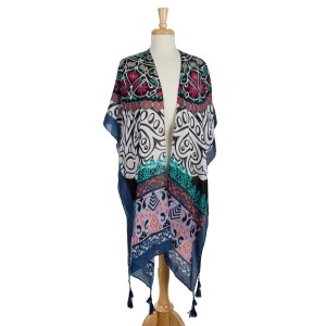 Lightweight, short sleeve kimono with an abstract print and tassel accents. 100% polyester. One size fits most.