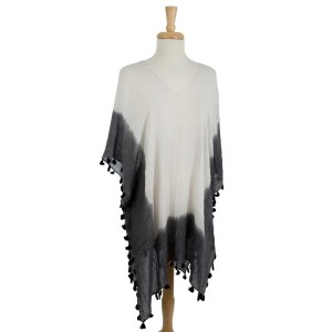 Lightweight, short sleeve kimono with an ombre print and tassel accents. 50% polyester and 50% viscose. One size fits most.