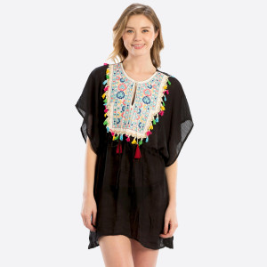 Lightweight, short sleeve top with an embroidery and tassel front design that can be worn as a swimsuit cover up. 50% viscose and 50% polyester. One size fits most.