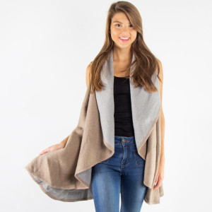 Double sided shawl vest. 100% acrylic. One size fits most.