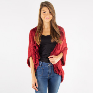 """Ruffle knit shrug. 100% acrylic. One size fits most. Approximately 36"""" in length."""
