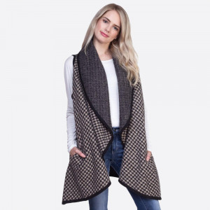 Houndstooth shawl vest. 50% acrylic and 50% nylon.  One size fits most.