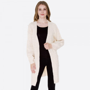 Long line cardigan with front pockets. 77% acrylic, 15% polyester, and 8% polyamide.  One size fits most.