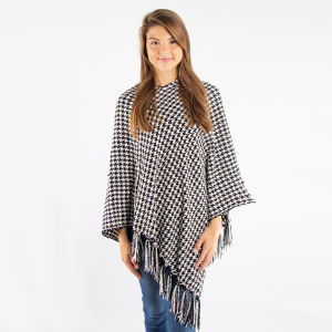 Chenille houndstooth poncho with fringe. 100% polyester.   One size fits most.