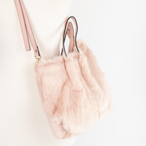 "Faux fur crossbag.    100% polyester. 12""W x 8""L."