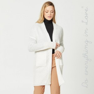 """Solid color lightweight knitted cardigan with front pocket details.  - One size fits most 0-14 - Approximately 37"""" in length  - 100% Acrylic"""