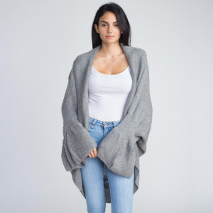 Cocoon long knit cardigan with ruffle. 85% acrylic and 15% Wool.   One size fits most.