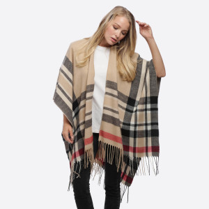 """Plaid print ruana/wrap with fringes.  - One size fits most 0-14 - Approximately 35"""" in length - 100% Acrylic"""