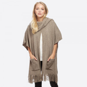 Knit poncho with front pockets. 100% acrylic.   One size fits most.