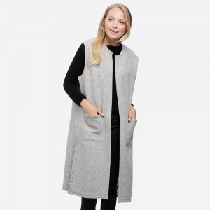 Long line vest with pockets.   - One size fits most 0-14 - 100% Polyester
