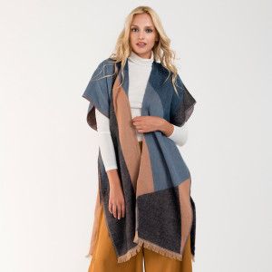 Geometric asymmetrical kimono. 100% acrylic.   One size fits most.