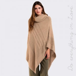 Very soft knit like poncho with turtle neck. 100% Acrylic One size fits most.