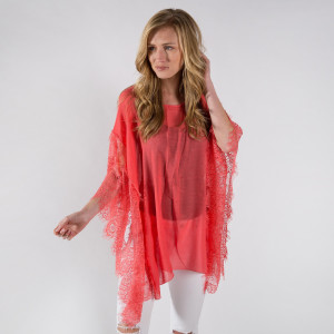 Light weight sheer poncho with lace sleeves. 30% cotton-70% polyester.