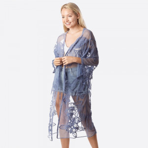 "Lightweight lace kimono featuring a floral print with butterfly details and a waist tie closure. Approximately 41"" in length.   One size fits most 0-14.  Composition: 50% Cotton 50% Polyester."