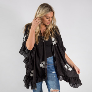 Ruffled kimono with floral details. Approximate 20% cotton-80% polyester.