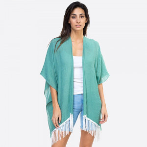 "Solid teal kimono with lace down the back and fringe detailing. One size fits most 0-14. Measures approximately 37"" x 27"" in size. 65% Polyester, 35% Cotton."