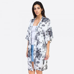 "Lightweight flower kimono. Measures approximately 27.5"" x 37."" 100% polyester."