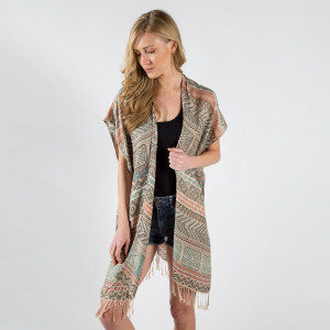 Mixed geometric kimono with fringes. One size fits most 0-14. 50% Cotton - 50% Polyester.