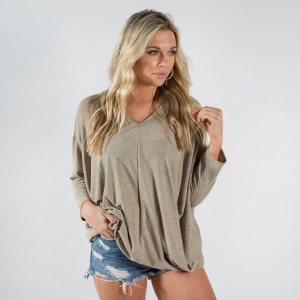 Loose fitting 3/4 sleeve length shirt. 100% polyester. One size fits most.
