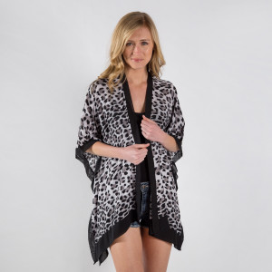 Sheer animal print bordered kimono. 100% viscose.