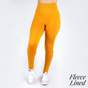 Mustard, one size fits all, full length, fleece lined leggings. Offered in everyday essential colors to coordinate with long tops, skirts or wear underneath clothing to keep warm.  92% Polyester and 8% spandex.