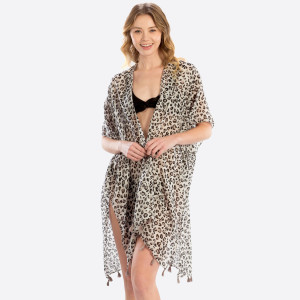 Light weight sheer leopard print cover up. 100% polyester 35.4X7. Fits most 0-14.