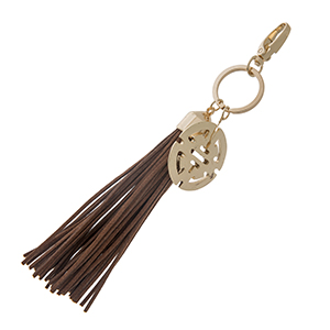 """Brown faux suede tassel with a gold tone 1 1/2"""" Aztec inspired charm. Can be used as a key chain or worn as a handbag or jewelry charm."""